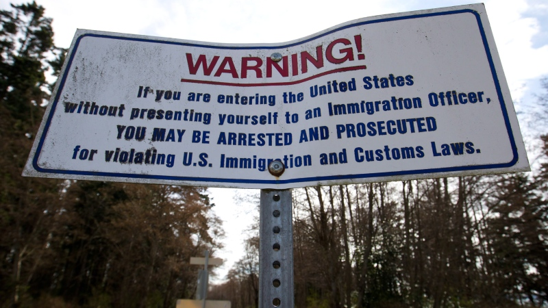 A warning sign seen at the Canada-U.S. border between Delta, B.C., and Monument Park in Point Roberts, Wash., on Tuesday March 13, 2012. (THE CANADIAN PRESS/Darryl Dyck)