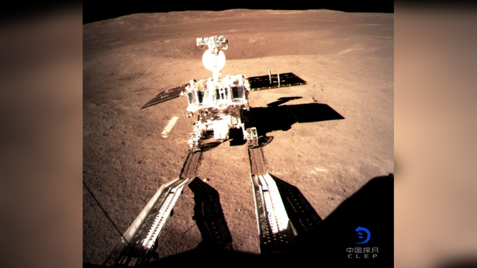 Yutu-2, China's lunar rover, leaves wheel marks after leaving the lander that touched down on the surface of the far side of the moon. (China National Space Administration / Xinhua News Agency via AP)