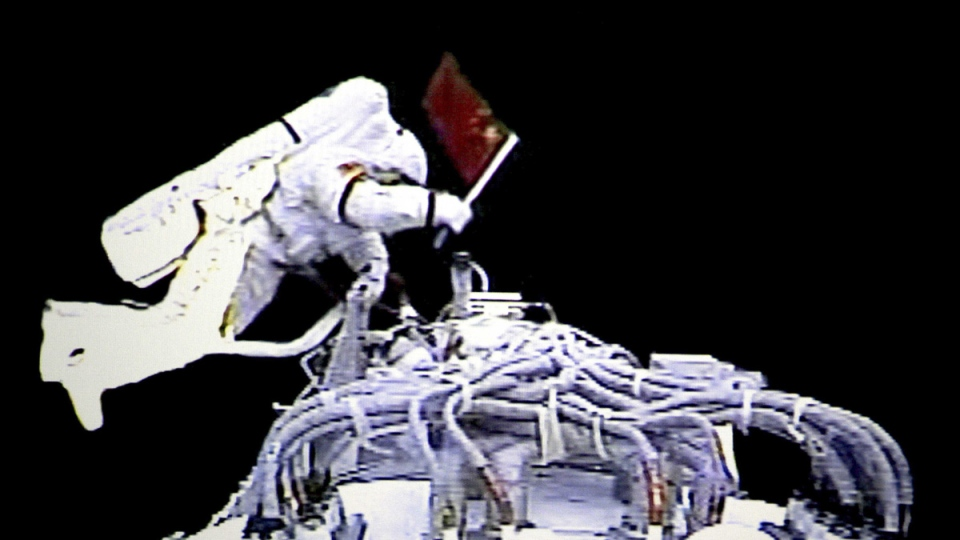 Chinese astronaut Zhai Zhigang walks outside the orbit module of the Shenzhou-7 spacecraft for a spacewalk after docking with the Chinese space station Tiangong 1, on Sept. 27, 2008. (Beijing Space Command and Control Center via Xinhua / AP)