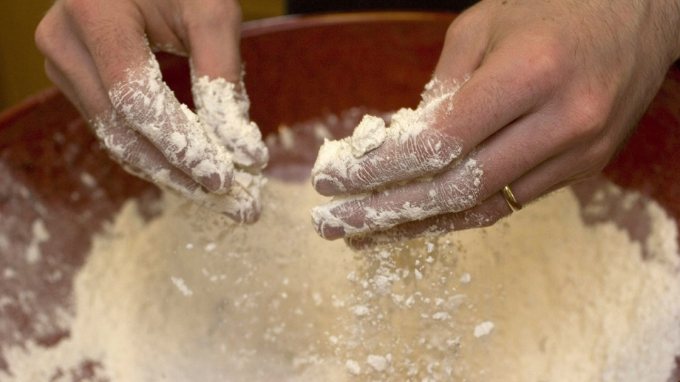 Working with flour. (Larry Crowe / AP)