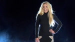 In this Oct. 18, 2018 file photo singer Britney Spears makes an appearance in front of the Park MGM hotel-casino in Las Vegas.  (Steve Marcus/Las Vegas Sun via AP,File)