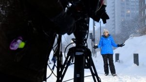A Weather Channel on-camera meteorologist reports on severe weather in Boston on Thursday, January 4, 2018. (Josh Reynolds/AP Images for The Weather Channel)