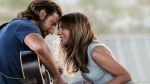 "This image released by Warner Bros. Pictures shows Bradley Cooper, left, and Lady Gaga in a scene from ""A Star is Born."" (Warner Bros. Pictures via AP)"