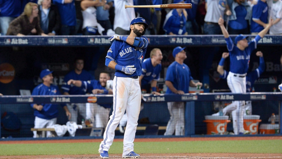 Toronto Blue Jays Jose Bautista flips his bat after hitting a three-run homer during seventh inning game 5 American League Division Series baseball action in Toronto on Wednesday, Oct. 14, 2015. (THE CANADIAN PRESS/Chris Young)