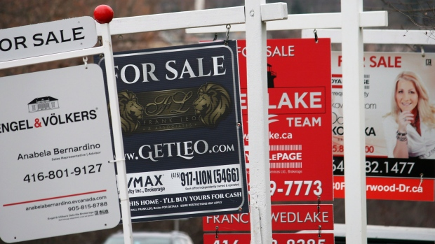 Real estate for sale signs are shown in Oakville,