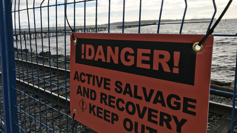 A sign warns visitors to White Rock Pier that the area is blocked off until repairs have been made. (David Molko / CTV Vancouver)