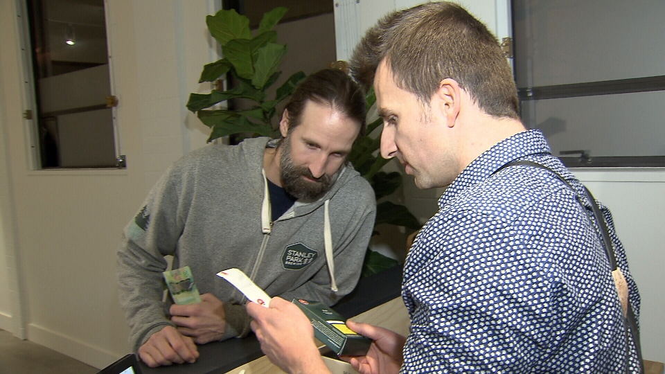 Cannabis Co. CEO (right) made the first legal pot sale in Vancouver on Friday night.
