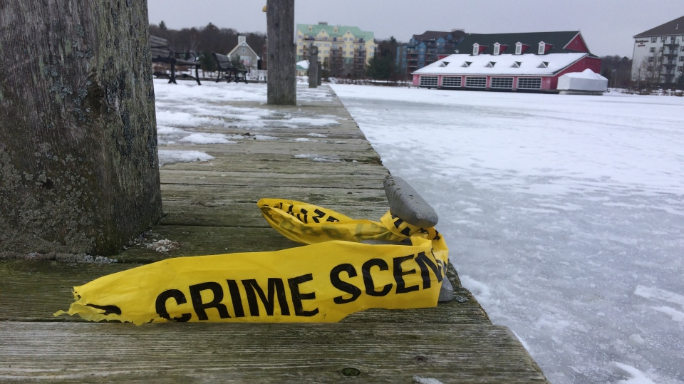 Police tape at the Muskoka Wharf where a 40-year-old man has died after crashing his snowmobile into the dock on Saturday evening (Don Wright/CTV News)