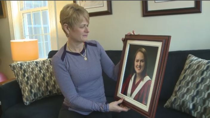 Katherine van Nostrand holds a photo of her daughter Emma.