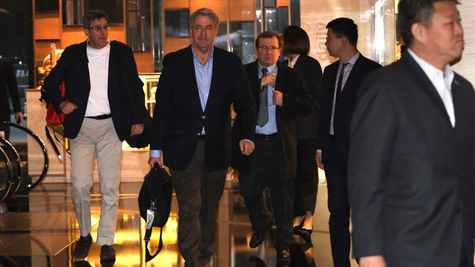 U.S. Undersecretary for Trade and Foreign Agricultural Affairs Ted McKinney, center arrives as part of a trade delegation at a hotel in Beijing, China, Sunday, Jan. 6, 2019. (AP Photo/Ng Han Guan)