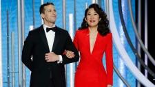 Andy Samberg and Sandra Oh