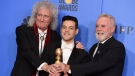 "Brian May, left, and Roger Taylor, right, of Queen, and Rami Malek pose in the press room with the award for best motion picture, drama for ""Bohemian Rhapsody"" at the 76th annual Golden Globe Awards at the Beverly Hilton Hotel on Sunday, Jan. 6, 2019, in Beverly Hills, Calif. (Photo by Jordan Strauss/Invision/AP)"