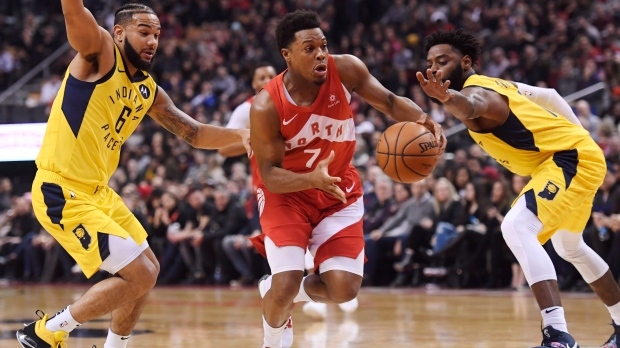 79d2f133fdd8 Toronto Raptors guard Kyle Lowry (7) drives between Indiana Pacers guard Cory  Joseph (6) and guard Tyreke Evans (12) during first half NBA basketball  action ...