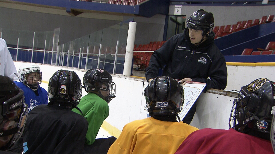 Youth hockey coach Stephen Gillis talks to his team. The peewee team put together a video seeking a kidney donor for Gillis, who is battling a rare and incurable disease.