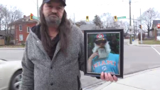 Rick Couckuit with a photo of Mark Billings