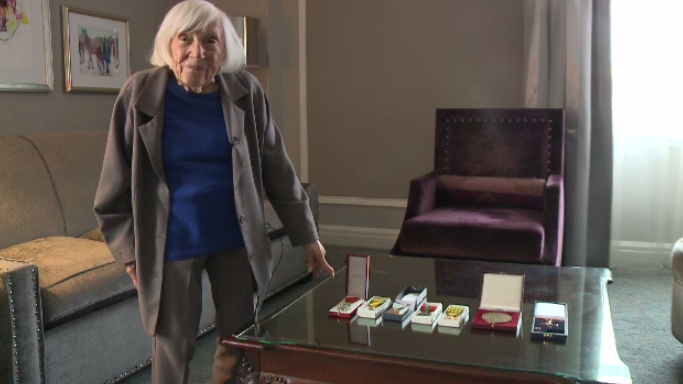 Marthe Cohn displaying her many service medals at the Hotel Saskatchewan in Regina. (Stefanie Davis/CTV Regina)