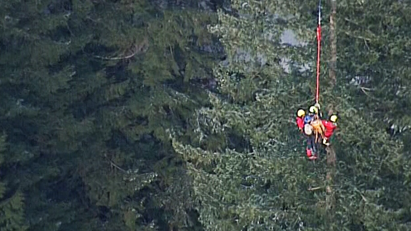 Members of North Shore rescue are seen dangling from a long-line on Monday, Jan. 7, 2019.