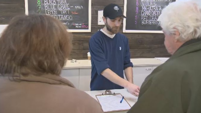 A sales person is shown at Trees Dispensary on Cook Street in Victoria. Jan. 7, 2019. (CTV Vancouver Island)