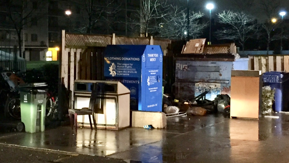 A woman found trapped in a donation box in Bloorcourt Village this morning has died, police confirm. (Michael Nguyen/ CP24)