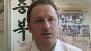 In this image made from video taken on March 2, 2017, Michael Spavor, director of Paektu Cultural Exchange, talks during a Skype interview in Yangi, China. (THE CANADIAN PRESS/AP Photo)