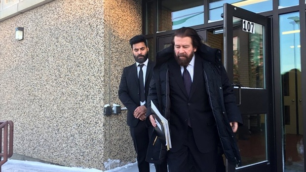 Truck driver in crash of hockey team's bus pleads guilty