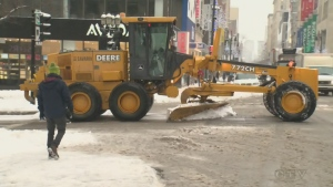 A snow plow crosses Ste. Catherine St. in downtown Montreal on Tuesday Jan. 8, 2019