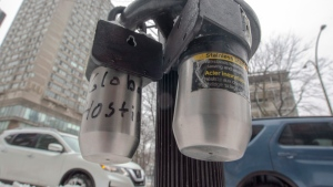 Lock boxes for keys to Airbnb units are seen attached to a parking meter post Tuesday, January 8, 2019 in Montreal. (THE CANADIAN PRESS/Ryan Remiorz)