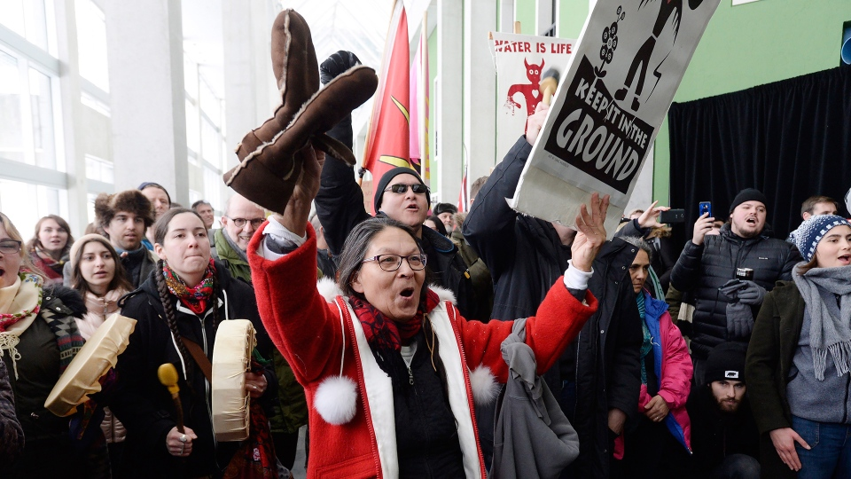 "Protesters storm a building where Prime Minister Justin Trudeau was scheduled to address a forum bringing together federal officials and representatives from self-governing First Nations that have ""modern"" treaties with the Crown in Ottawa on Tuesday, Jan. 8, 2019. THE CANADIAN PRESS/Adrian Wyld"