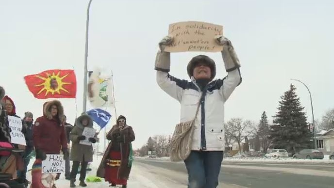 People protesting a pipeline project in British Columbia gather outside the Regina RCMP (CTV Regina)