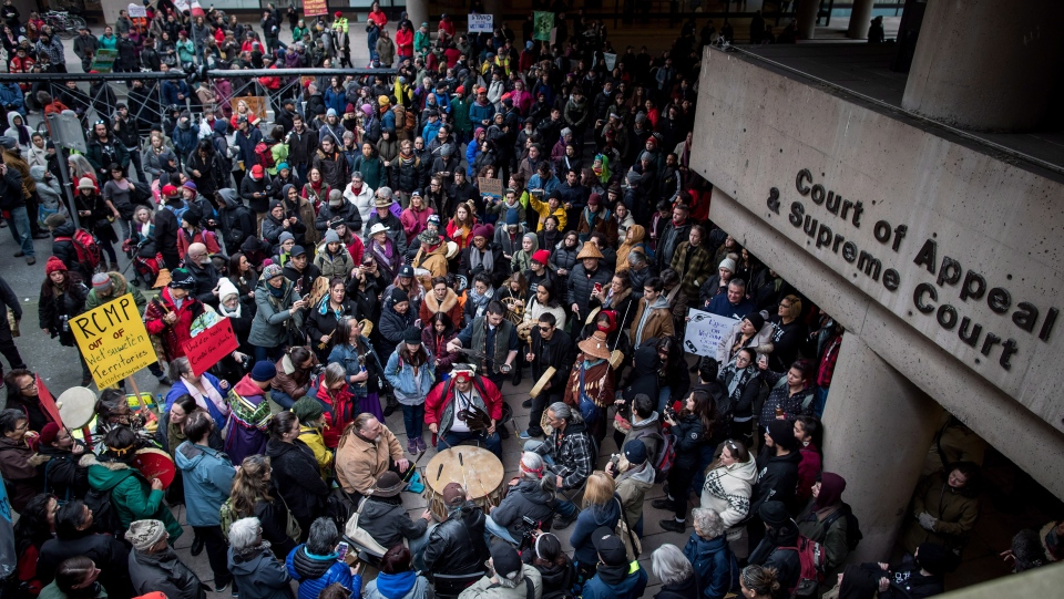 Protesters gather as First Nations drummers play during a rally before a march in support of pipeline protesters in northwestern British Columbia, in Vancouver, on Tuesday, Jan. 8, 2019. (THE CANADIAN PRESS/Darryl Dyck)