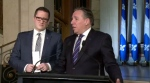 Benoit Charette and Francois Legault at a news conference to name Charette as the next environment minister.