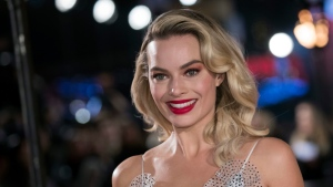 "In this Monday, Dec. 10, 2018, file photo, actress Margot Robbie poses for photographers upon her arrival at the premiere of the film ""Mary Queen of Scots,"" in London. (Photo by Vianney Le Caer/Invision/AP)"