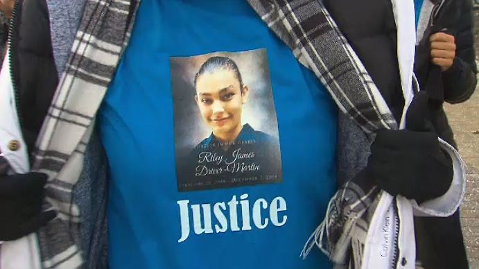 Family members of Riley Driver-Martin wore T-shirts with the 14-year-old's picture on it to a court appearance for one of the two men accused in his death on January 9, 2019.