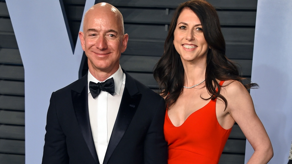 FILE - In this March 4, 2018 file photo, Jeff Bezos and wife MacKenzie Bezos arrive at the Vanity Fair Oscar Party in Beverly Hills, Calif. (Photo by Evan Agostini/Invision/AP, File)
