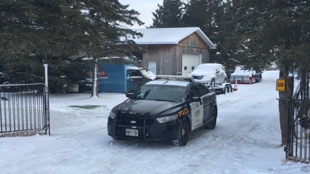 A police cruiser in a snowy driveway