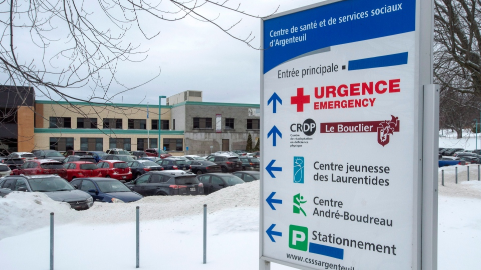 Some of the English words on the sign at the regional hospital have been covered. THE CANADIAN PRESS/Ryan Remiorz