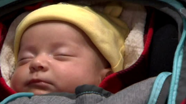 One of Joseph Tito's baby girls is seen at Toronto Pearson International Airport.