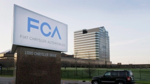 In this May 6, 2014, file photo, a vehicle moves past a sign outside Fiat Chrysler Automobiles world headquarters in Auburn Hills, Mich. (AP Photo/Carlos Osorio, File)