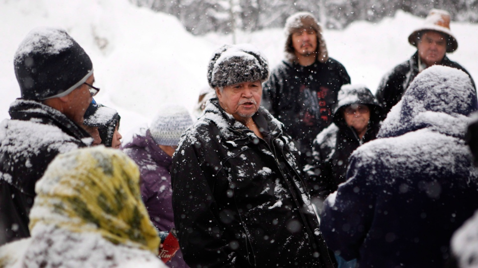 Chief Madeek, hereditary leader of the Gidimt'en clan talks with supporters of the Unist'ot'en camp and Wet'suwet'en people near a checkpoint camp fire off a logging near Houston, B.C., on Wednesday, January 9, 2019. THE CANADIAN PRESS/Chad Hipolito