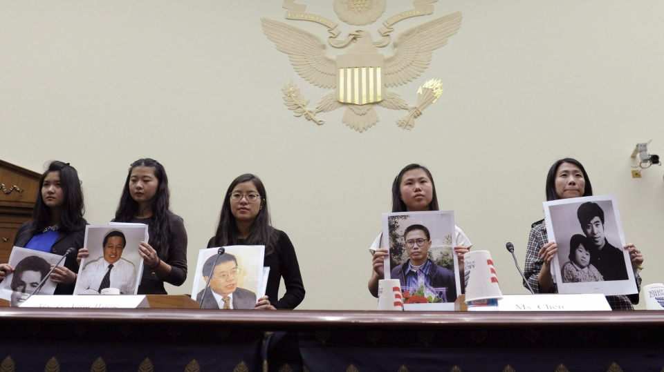 "From left, Lisa Peng, Grace Ge Geng, Ti-Anna Wang,  Bridgette Chen and Danielle Wang are introduced prior to testifying before the House Foreign Affairs Committee hearing entitled, ""Their Daughters Appeal to Beijing: 'Let Our Fathers Go,! on Capitol Hill in Washington, Thursday, Dec. 5, 2013. THE CANADIAN PRESS/AP, Susan Walsh"