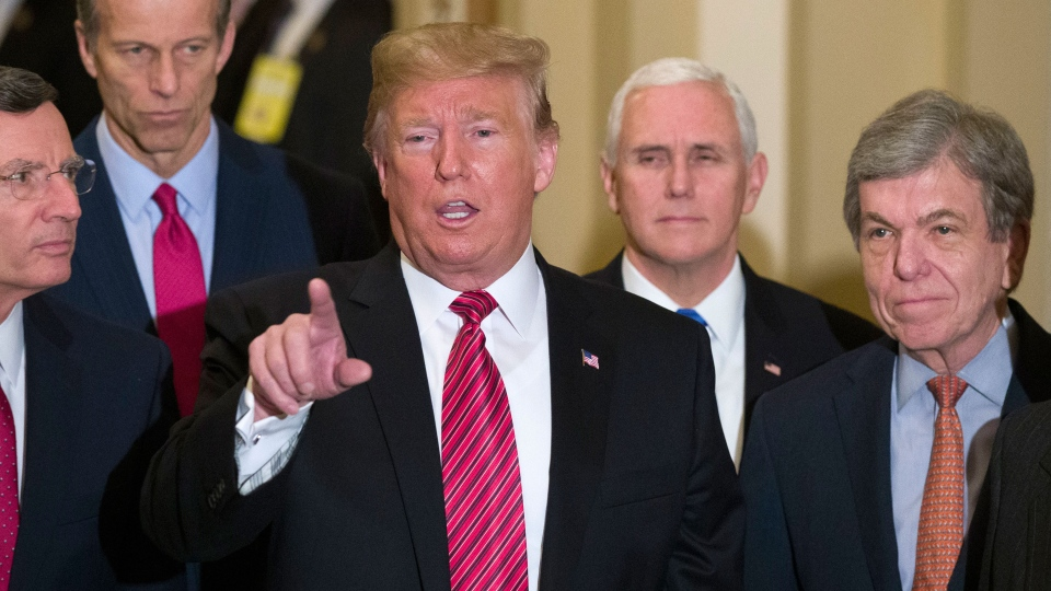 U.S. Sen. John Barrasso, R-Wyo., left, and Sen. John Thune, R-S.D., stand with U.S. President Donald Trump, Vice President Mike Pence, Sen. Roy Blunt, R-Mo., and Senate Majority Leader Mitch McConnell of Ky., as Trump speaks while departing after a Senate Republican Policy luncheon, on Capitol Hill in Washington, Wednesday, Jan. 9, 2019. (AP Photo/Alex Brandon)