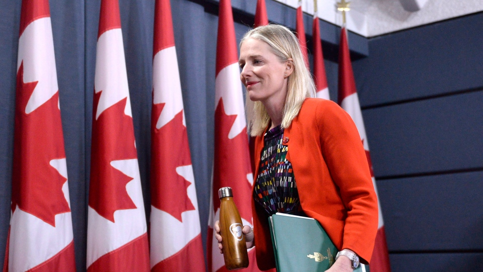 Minister of Environment and Climate Change Catherine McKenna leaves a press conference on Canada's climate plan, in the National Press Theatre in Ottawa on Thursday, Dec. 20, 2018. (THE CANADIAN PRESS/Justin Tang)