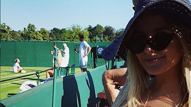 Charlotte Bouchard at Wimbledon with her sister, Eugenie, in the background.
