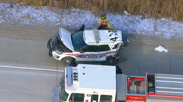 A damaged York Regional Police cruiser sits on the side of Highway 407 after a crash with another vehicle in Vaughan on January 10, 2019.