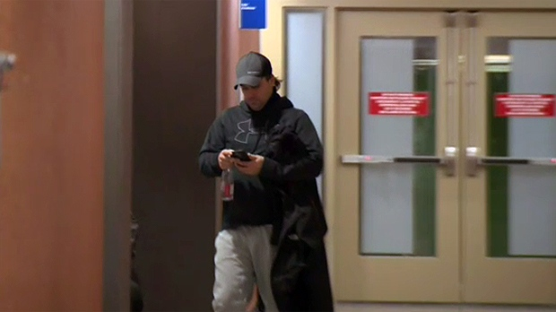 Danny Arsenault, accused of harassing Charlotte Bouchard, walks through a Montreal courthouse on Jan. 10, 2018