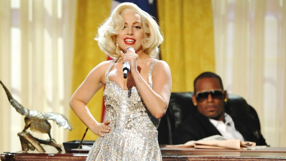 In this Nov. 24, 2013 file photo, Lady Gaga and R. Kelly perform