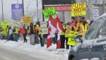 Protesters line the access road in Kamloops, B.C. where Prime Minister Justin Trudeau spoke at a Liberal fundraising luncheon on Wednesday Jan. 9, 2019.THE CANADIAN PRESS/Murray Mitchell