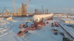 A piece of petrochemical equipment as long as Big Ben arrives at a work site in Fort Saskatchewan, Alta. on January 10, 2019.