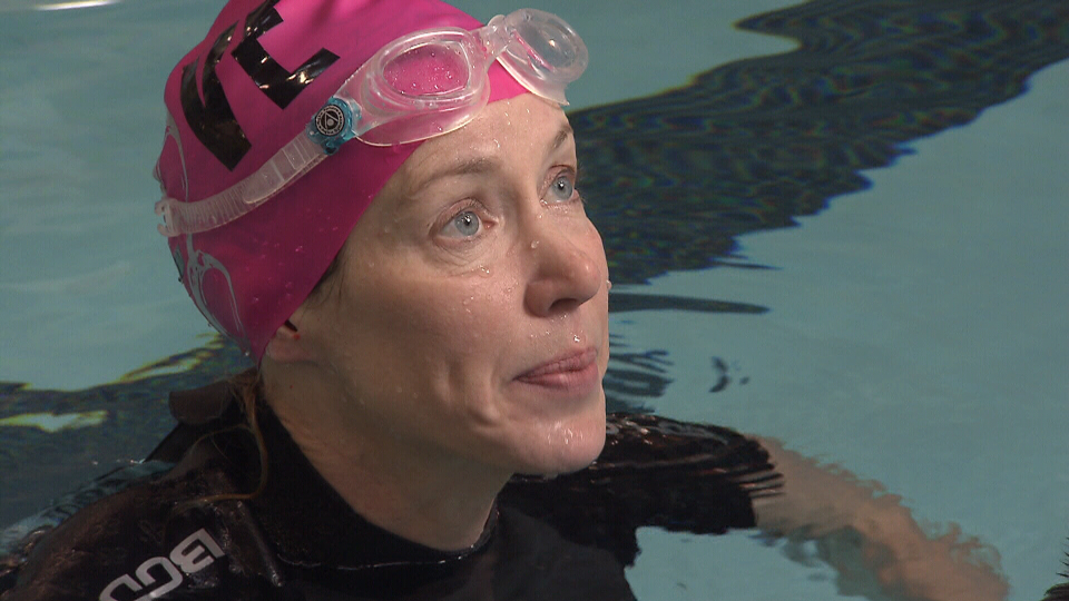 Kelly Seib is seen swimming to raise money for Tashina Janus.