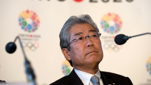 Tsunekazu Takeda, President of the Tokyo 2020 Olympic games bid, listens to a question from the media during the first international presentation of the Tokyo 2020 Olympic Games bid in London, Jan. 10, 2013. (AP Photo/Alastair Grant, File)